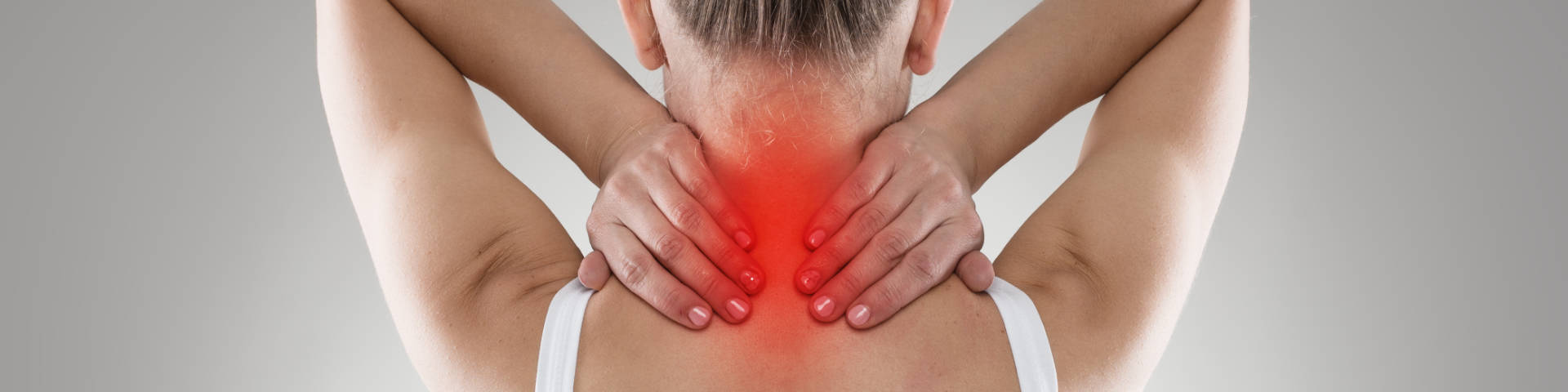 woman suffering from upper back and spine pain