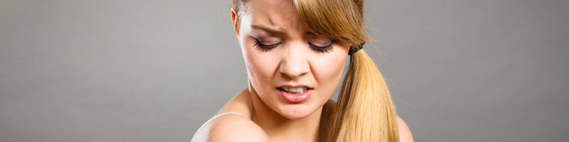 young woman suffering from chronic pain