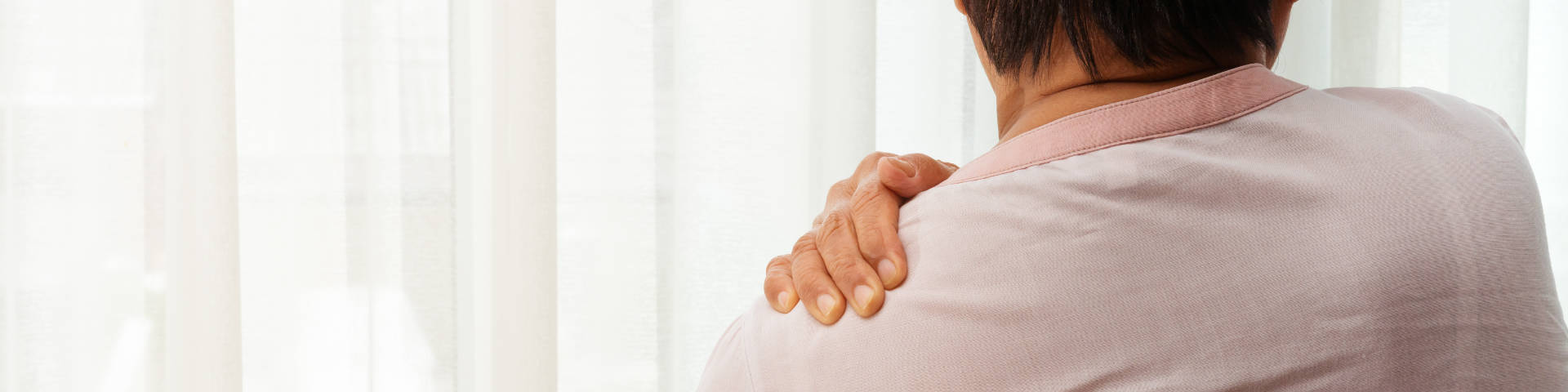 person suffering from shoulder pain