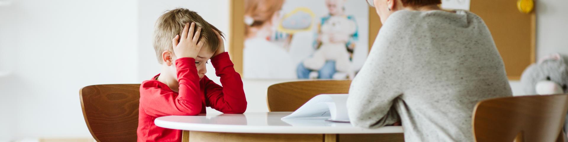 ADHD Treatment Specialist Talking to Upset Little Boy
